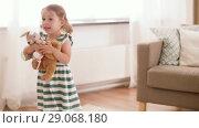 Купить «happy baby girl playing with soft toys at home», видеоролик № 29068180, снято 10 августа 2018 г. (c) Syda Productions / Фотобанк Лори