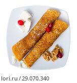 Купить «Dish of pancakes palachinki with filling from brynza and walnuts», фото № 29070340, снято 23 августа 2019 г. (c) Яков Филимонов / Фотобанк Лори