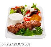 Купить «Tasty fried balkan kebapcheta served with salad of greens and b», фото № 29070368, снято 18 июня 2019 г. (c) Яков Филимонов / Фотобанк Лори