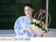 Купить «Smiling student stays near blackboard in classroom», фото № 29070868, снято 25 июля 2018 г. (c) Papoyan Irina / Фотобанк Лори
