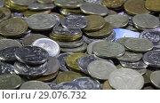 Купить «A lot of coins and cents rubles. Throwing coins into a common heap. Russian rubles.», видеоролик № 29076732, снято 23 июля 2019 г. (c) Леонид Еремейчук / Фотобанк Лори