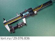 Купить «Measurement of the details by a digital caliper», фото № 29076836, снято 25 февраля 2018 г. (c) Куликов Константин / Фотобанк Лори