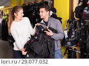 Купить «Woman seller is helping man choose new diving equipment in the store.», фото № 29077032, снято 25 января 2018 г. (c) Яков Филимонов / Фотобанк Лори