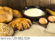 Купить «Food. Rustic still life. Fresh bread baked in a bakery, chicken eggs and cottage cheese on a background of a wooden table texture», фото № 29082524, снято 25 августа 2018 г. (c) Светлана Евграфова / Фотобанк Лори