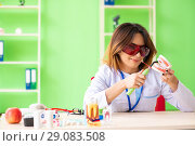 Купить «Woman dentist working on teeth implant», фото № 29083508, снято 11 июня 2018 г. (c) Elnur / Фотобанк Лори