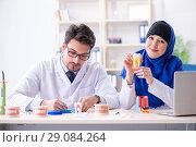 Купить «Dentist doctor and assistant working on new tooth implant», фото № 29084264, снято 24 апреля 2018 г. (c) Elnur / Фотобанк Лори