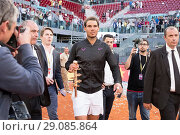 Купить «Rafael Nadal of Spain after beating Dominic Thiem of Austria to win his fifth Madrid Open title at La Caja Magica in Madrid, Spain. Featuring: Rafael Nadal...», фото № 29085864, снято 14 мая 2017 г. (c) age Fotostock / Фотобанк Лори