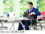 Купить «Disabled businessman working in the office», фото № 29087808, снято 31 мая 2018 г. (c) Elnur / Фотобанк Лори