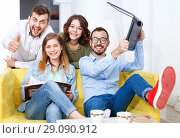 Купить «Young people friendly discussing while sitting with laptop in co», фото № 29090912, снято 24 мая 2018 г. (c) Яков Филимонов / Фотобанк Лори