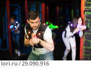 Купить «Excited guy during lasertag game», фото № 29090916, снято 25 апреля 2018 г. (c) Яков Филимонов / Фотобанк Лори