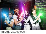 Купить «Young people in laser tag labyrinth», фото № 29090920, снято 25 апреля 2018 г. (c) Яков Филимонов / Фотобанк Лори