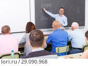 Купить «Young lecturer talking to mixed age students», фото № 29090968, снято 28 июня 2018 г. (c) Яков Филимонов / Фотобанк Лори