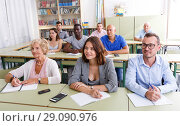 Купить «Students mixed age listening task for exam», фото № 29090976, снято 28 июня 2018 г. (c) Яков Филимонов / Фотобанк Лори