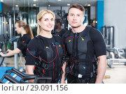 Купить «young people dressed in EMS vests», фото № 29091156, снято 16 апреля 2018 г. (c) Яков Филимонов / Фотобанк Лори