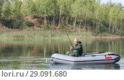 Купить «Senior fisherman floats on a lake on an inflatable boat with a fishing rod», видеоролик № 29091680, снято 14 сентября 2018 г. (c) Алексей Кузнецов / Фотобанк Лори