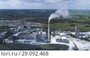 Купить «Cement factory, industrial enterprise. The smoking factory chimney.», видеоролик № 29092468, снято 4 сентября 2018 г. (c) Андрей Радченко / Фотобанк Лори