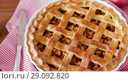 Купить «close up of apple pie and knife on wooden table», видеоролик № 29092820, снято 7 сентября 2018 г. (c) Syda Productions / Фотобанк Лори