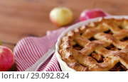 Купить «close up of apple pie and knife on wooden table», видеоролик № 29092824, снято 7 сентября 2018 г. (c) Syda Productions / Фотобанк Лори