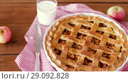 Купить «close up of apple pie and glass of milk on table», видеоролик № 29092828, снято 12 сентября 2018 г. (c) Syda Productions / Фотобанк Лори