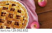 Купить «close up of apple pie on wooden table», видеоролик № 29092832, снято 7 сентября 2018 г. (c) Syda Productions / Фотобанк Лори