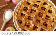 Купить «close up of apple pie on wooden table», видеоролик № 29092836, снято 7 сентября 2018 г. (c) Syda Productions / Фотобанк Лори