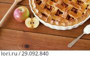Купить «close up of apple pie on wooden table», видеоролик № 29092840, снято 7 сентября 2018 г. (c) Syda Productions / Фотобанк Лори