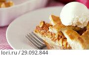 Купить «close up of apple pie with ice cream on plate», видеоролик № 29092844, снято 7 сентября 2018 г. (c) Syda Productions / Фотобанк Лори