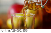 Купить «apple juice pouring from bottle to glass», видеоролик № 29092856, снято 7 сентября 2018 г. (c) Syda Productions / Фотобанк Лори