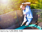 Купить «Active girl leaping in the air on a trampoline», фото № 29093140, снято 20 мая 2018 г. (c) Сергей Новиков / Фотобанк Лори