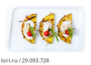 Купить «Image of sepia fried on a grill with pineapple, cherry tomatoes and sauce Chile», фото № 29093728, снято 17 октября 2018 г. (c) Яков Филимонов / Фотобанк Лори