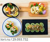 Купить «Dishes with squid and sepia», фото № 29093732, снято 23 сентября 2018 г. (c) Яков Филимонов / Фотобанк Лори