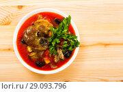 Купить «Top view of spicy tomato soup with lamb, prunes, dried apricots», фото № 29093796, снято 16 августа 2018 г. (c) Яков Филимонов / Фотобанк Лори