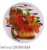 Купить «Top view of lamb ribs baked with spicy tomato sauce», фото № 29093824, снято 18 сентября 2018 г. (c) Яков Филимонов / Фотобанк Лори