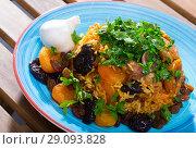 Купить «Pilaf from mutton with dried apricots, prunes», фото № 29093828, снято 17 октября 2018 г. (c) Яков Филимонов / Фотобанк Лори