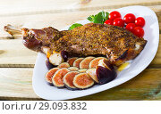 Купить «Baked shoulder of lamb served with fig, feta cheese, herbs and cherry tomatoes at plate», фото № 29093832, снято 18 октября 2018 г. (c) Яков Филимонов / Фотобанк Лори