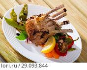 Купить «BBQ lamb carre served with vegetables», фото № 29093844, снято 18 февраля 2019 г. (c) Яков Филимонов / Фотобанк Лори