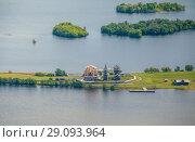 Купить «Aerial view of Kizhi island with old russian wooden architecture in Karelia, Russia. Summer day.», эксклюзивное фото № 29093964, снято 9 июня 2018 г. (c) Сергей Цепек / Фотобанк Лори