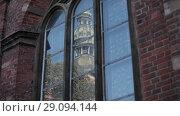 Купить «Church tower in the reflection of glass», видеоролик № 29094144, снято 8 августа 2018 г. (c) Aleksejs Bergmanis / Фотобанк Лори