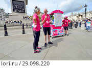 Купить «Team London Ambassadors, volunteers helping tourists in Trafalgar Square, London, England, UK. A scheme started for visitors to the 2012 Olympics and continued for tourists visiting London.», фото № 29098220, снято 17 августа 2018 г. (c) age Fotostock / Фотобанк Лори