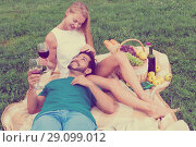 Купить «Boyfiend is relaxing on the lap of female», фото № 29099012, снято 10 августа 2017 г. (c) Яков Филимонов / Фотобанк Лори
