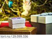 Купить «Gift boxes with bows on the lids under a Christmas tree in New Year Eve», фото № 29099336, снято 1 января 2018 г. (c) Георгий Дзюра / Фотобанк Лори