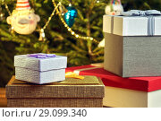 Купить «Gift boxes with bows on the lids under a Christmas tree in New Year Eve», фото № 29099340, снято 1 января 2018 г. (c) Георгий Дзюра / Фотобанк Лори