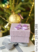 Купить «Gift boxes with bows on the lids under a Christmas tree in New Year Eve», фото № 29099388, снято 1 января 2018 г. (c) Георгий Дзюра / Фотобанк Лори