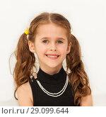 Купить «Happy seven years old girl smiling at camera», фото № 29099644, снято 15 апреля 2017 г. (c) Сергей Новиков / Фотобанк Лори