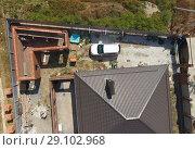 Купить «The brown roof of the new house. Home construction», фото № 29102968, снято 26 мая 2019 г. (c) Леонид Еремейчук / Фотобанк Лори