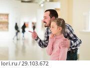 Купить «interested father and daughter exploring expositions in museum», фото № 29103672, снято 20 сентября 2018 г. (c) Яков Филимонов / Фотобанк Лори