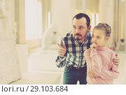 Купить «Father and small girl looking ancient statues», фото № 29103684, снято 20 сентября 2018 г. (c) Яков Филимонов / Фотобанк Лори