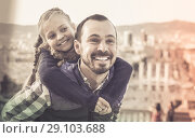 Купить «Man and daughter enjoying city walk together», фото № 29103688, снято 20 сентября 2018 г. (c) Яков Филимонов / Фотобанк Лори
