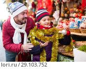 Купить «Happy persons are buying X-mas decorations», фото № 29103752, снято 20 сентября 2018 г. (c) Яков Филимонов / Фотобанк Лори