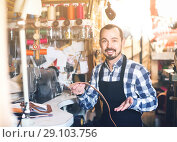Купить «male worker sewing stitches on belt in leather workshop», фото № 29103756, снято 20 января 2019 г. (c) Яков Филимонов / Фотобанк Лори